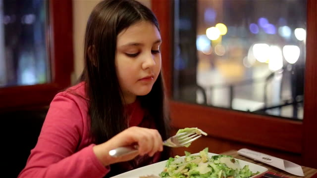 little girl eating in restaurant - plate of food stock videos & royalty-free footage