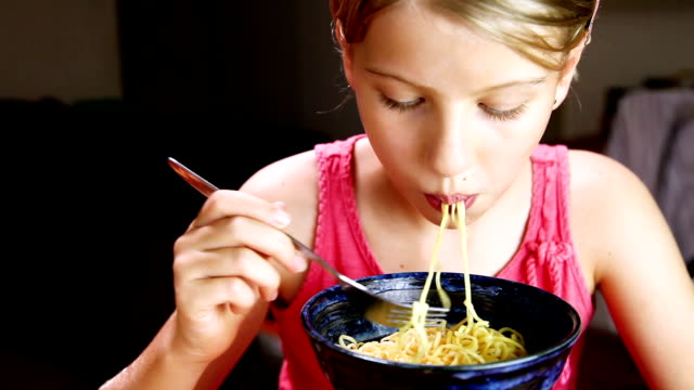 little girl eating noodles - noodles stock videos & royalty-free footage