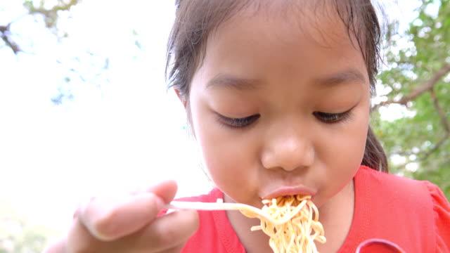 Little Girl Eating Noodles