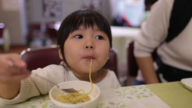 little girl eating ramen noddle for lunch - straight hair stock videos & royalty-free footage