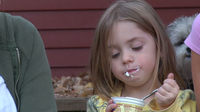 little girl eating yogurt 720p30 - yoghurt stock videos and b-roll footage