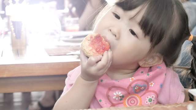 little girl eating yummy cake. - cupcake stock videos and b-roll footage