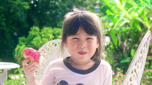 little girl eating yummy dessert. - sweet food stock videos & royalty-free footage