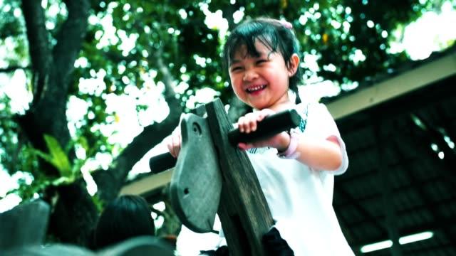 Little girl(4-5 years) enjoying at the playground
