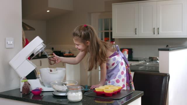 4K: Little Girl Enjoying Raw Cake off the Mixer
