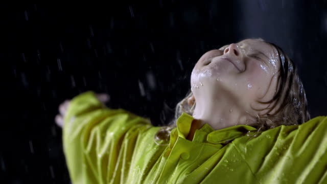 little girl enjoying the heavy rain - blonde hair stock videos & royalty-free footage