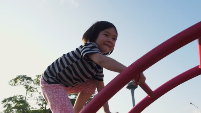 little girl enjoyment at the playground - baby girls stock videos & royalty-free footage
