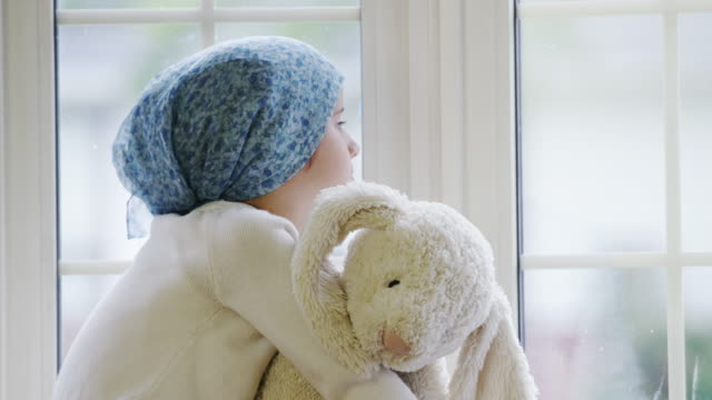 Little Girl Experiencing Cancer Treatment