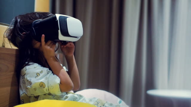 Little girl experiencing Virtual Reality Simulator
