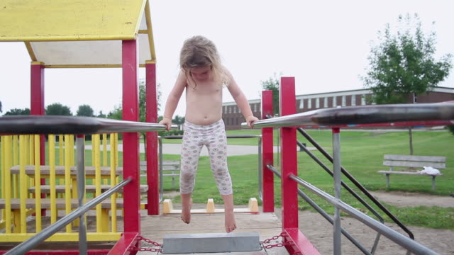 ms little girl experiments on monkey bars at an playground / toronto, ontario, canada  - shirtless stock videos and b-roll footage