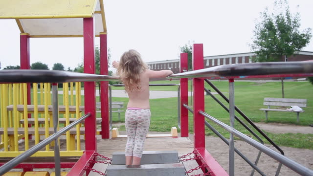 ms td little girl experiments on monkey bars at  playground / toronto, ontario, canada  - kelly mason videos stock videos & royalty-free footage