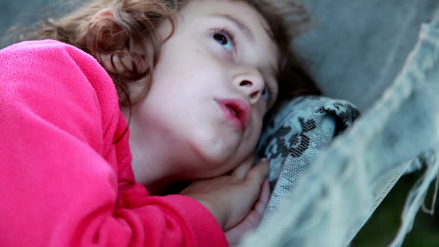 little girl falling asleep in the hammock - moving activity stock videos & royalty-free footage