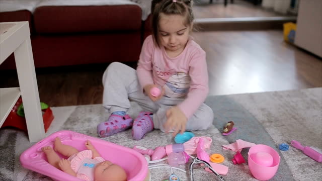 little girl feeding his little doll friend - doll stock videos & royalty-free footage