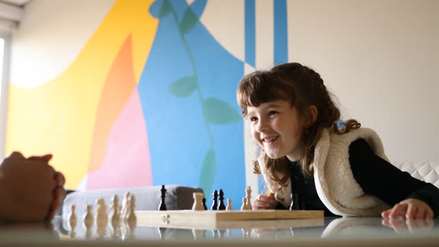 little girl finishing the game with a checkmate - dia stock videos & royalty-free footage
