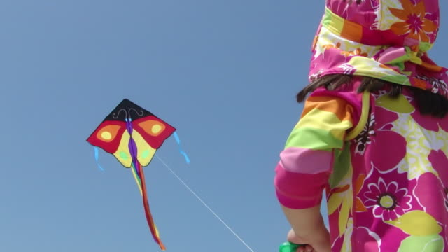little girl flying a kite - kite toy stock videos and b-roll footage
