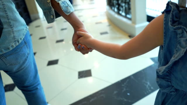 little girl hand holding together with mother - girls videos stock videos & royalty-free footage