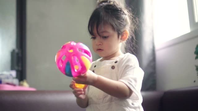 little girl have fun with her toys - toddler stock videos & royalty-free footage