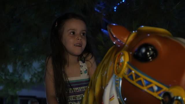 Little Girl Having Fun At The Amusement Park.