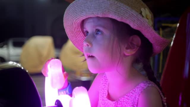 little girl having fun at the amusement park. - amusement park stock videos & royalty-free footage