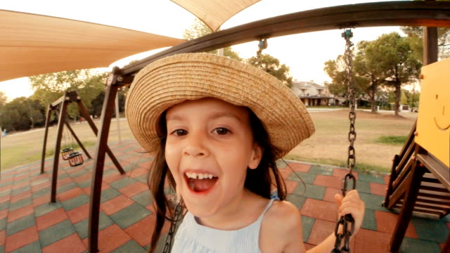 little girl having fun at the park. - swinging stock videos & royalty-free footage