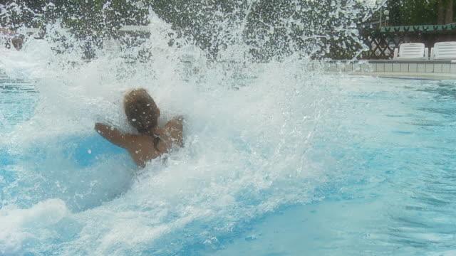 hd slow motion: little girl having fun in pool - swimwear stock videos & royalty-free footage