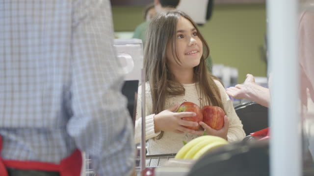 little girl helping with checking out at the supermarket - checkout stock videos & royalty-free footage