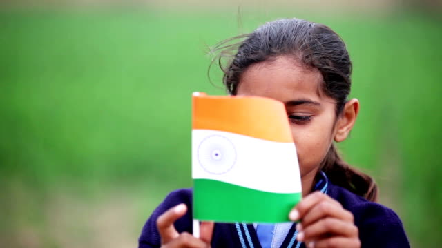 little girl holding indian national flag in the nature - social issues stock videos & royalty-free footage