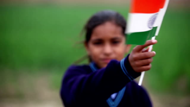 little girl holding indian national flag in the nature - school uniform stock videos & royalty-free footage