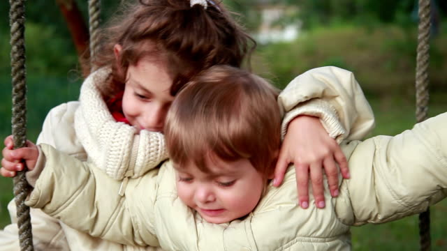 little girl hugging her baby siter but she starts to cry - babies in a row stock videos & royalty-free footage