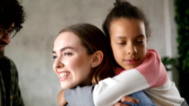 Little girl hugging new foster mom