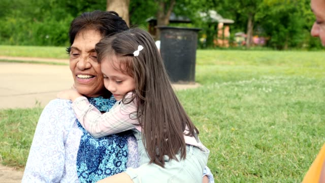 little girl hugs her great grandmother - candid stock videos & royalty-free footage