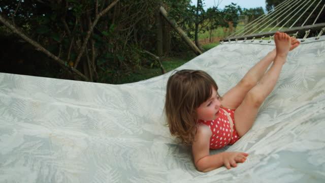 little girl in a hammock - hammock stock videos & royalty-free footage