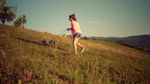 vídeos de stock e filmes b-roll de little girl in a walk with puppy - children only