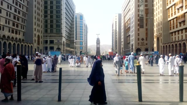 little girl (pilgrim) in abaya dress playing outside the prophet's mosque. - saudi arabia stock videos & royalty-free footage