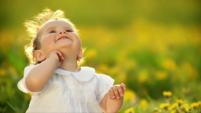 hd slow-motion: little girl in nature - babies only stock videos & royalty-free footage
