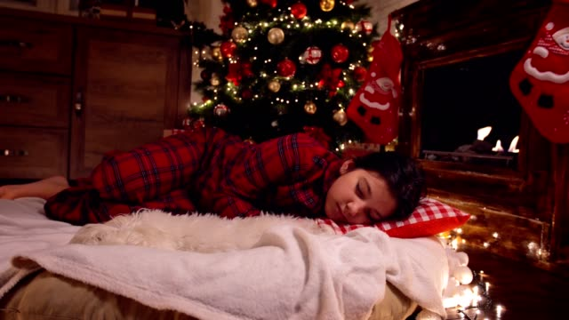 little girl in pajama fell asleep near tree on christmas eve - cosy stock videos & royalty-free footage