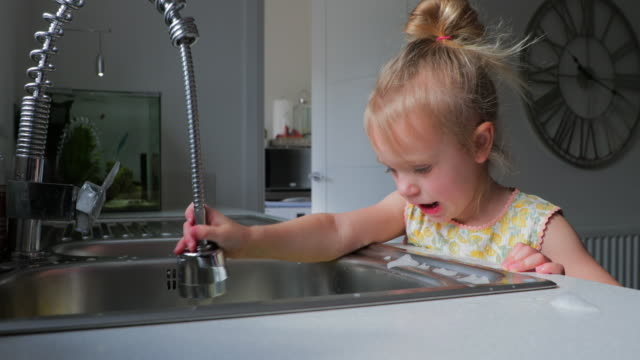 little girl in the kitchen - washing up stock videos & royalty-free footage