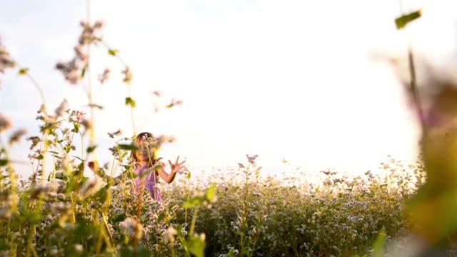 SLO MO Little girl in the middle of buckwheat field