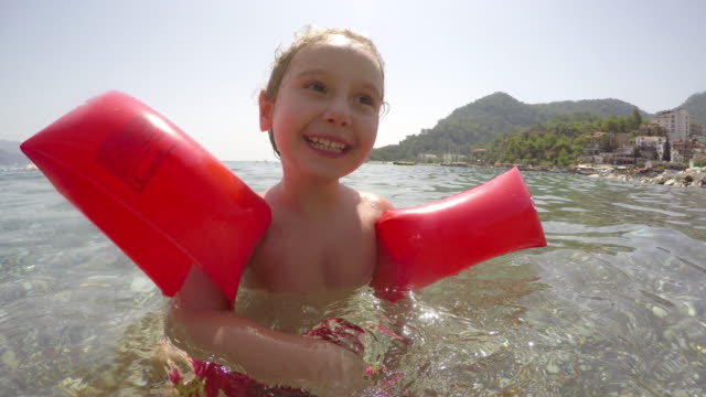 little girl in the sea - inflatable stock videos & royalty-free footage