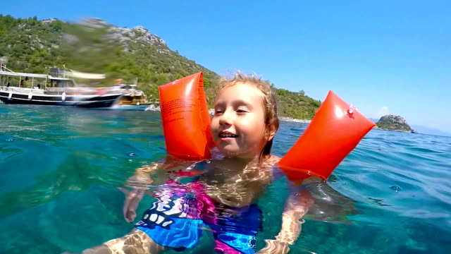 little girl in the sea - arm band stock videos & royalty-free footage