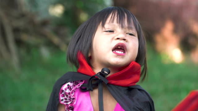 little girl in vampire costume posing for camera, makeup as evil spirits on halloween. - count dracula stock videos & royalty-free footage