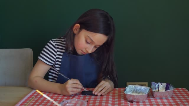 little girl is painting stone at home - stone object stock videos & royalty-free footage