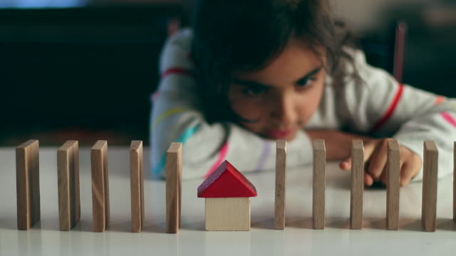 little girl is playing with wooden block at home - block shape stock videos & royalty-free footage