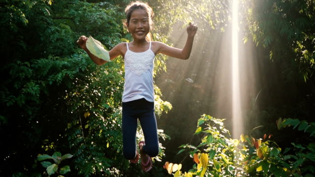 little girl jumping in the jungles - indonesia stock videos & royalty-free footage