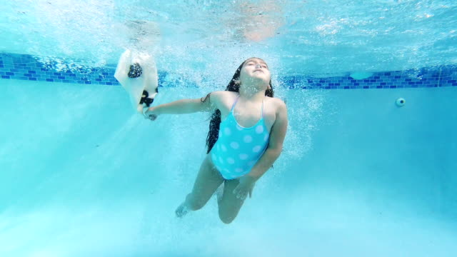 little girl jumping in the pool with an animal mask - girl swimming costume stock videos & royalty-free footage