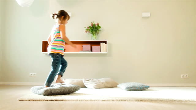 little girl jumping over pillows - one girl only stock videos & royalty-free footage