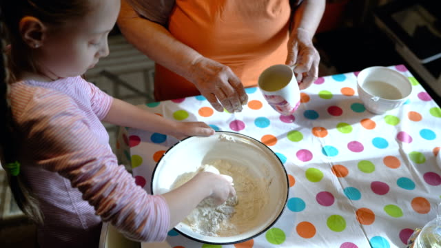 little girl kneading dough - utensil stock videos & royalty-free footage