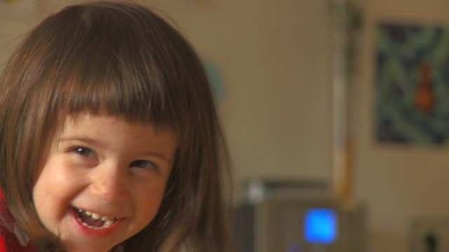 hd: little girl laughing - brown hair stock videos & royalty-free footage