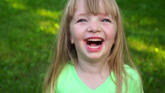 Little girl laughs