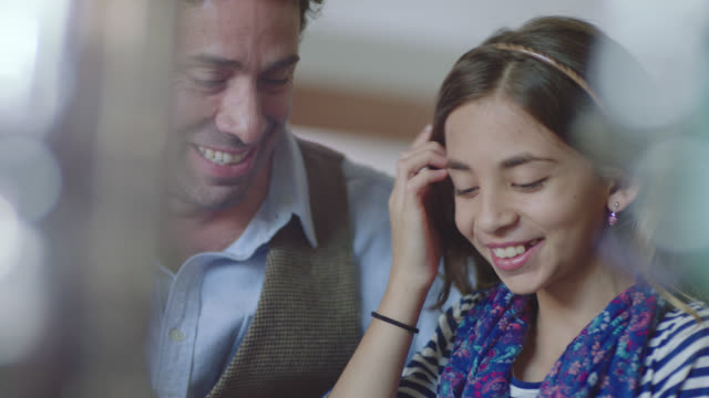 vidéos et rushes de ms. little girl laughs with her dad on fun father daughter coffee shop date. - 12 13 ans